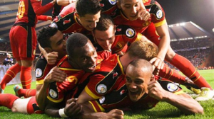 Vincent Kompany is mobbed by his Belgian team-mates.