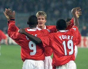 David Beckham, Andy Cole and Dwight Yorke celebrate during the treble-winning season of 1998/99.